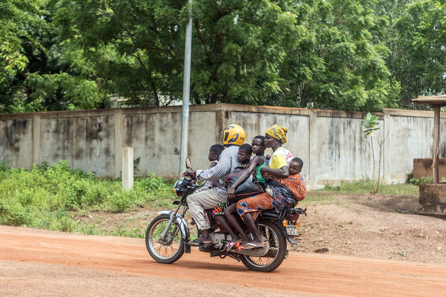 A family ride a motorbike as they flee the city of Save, on June 15, following days of unrest in the West African country of Benin. YANICK FOLLY/AFP/Getty Images