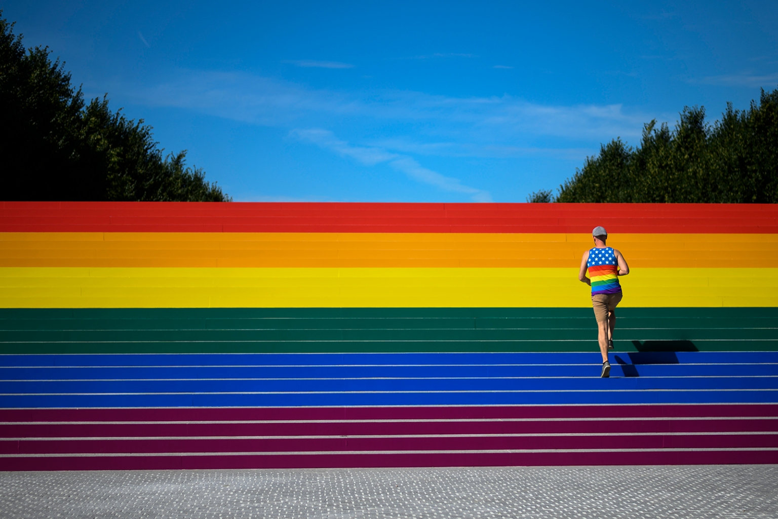 A man walks on steps covered in rainbow colors for Pride Month at Franklin D. Roosevelt Four Freedoms Park in New York City on June 15. Organizers say it is the largest LGBT pride flag in New York City, measuring around 12 by 100 feet. JOHANNES EISELE/AFP/Getty Images