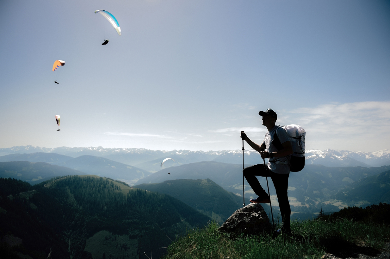 French athlete Benoit Outters looks at paragliders flying during a training session prior to the Red Bull X-Alps race in Bergbahnen Werfenweng, western Austria, on June 14. The race crosses the borders of six countries covering alpine terrain only on foot and by paragliding. LUCAS BARIOULET/AFP/Getty Images
