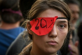 A protester wearing a red eye patch attends a rally in front of the Georgian Parliament building in Tbilisi on June 21.