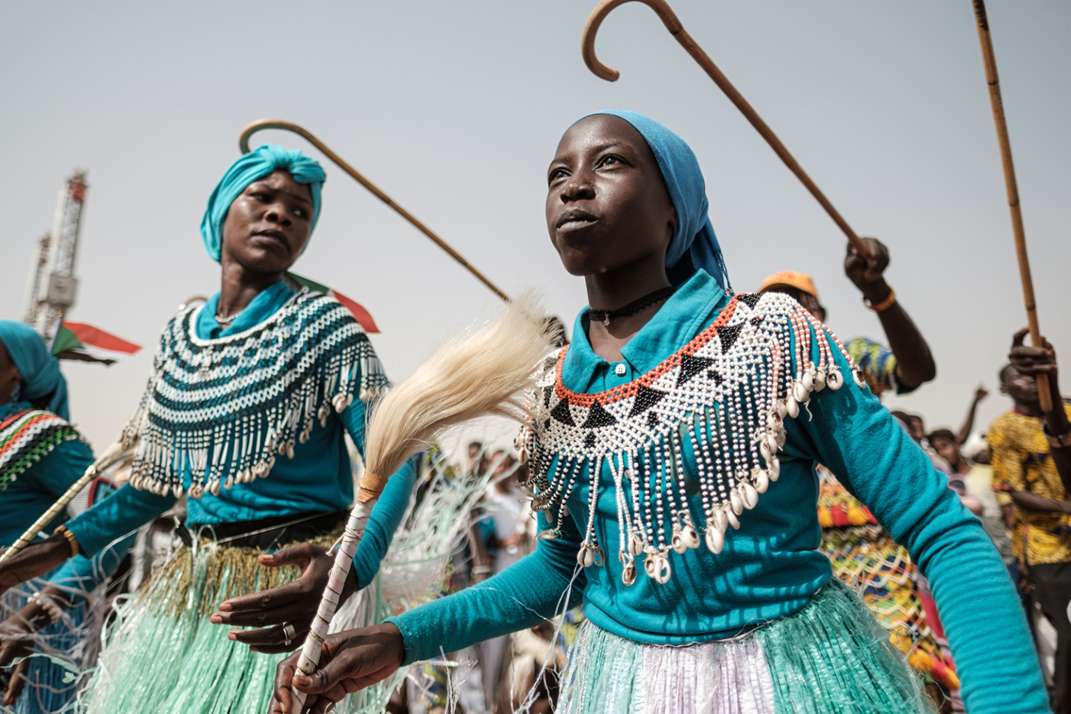 Members of a traditional music and dance group perform before a rally for supporters of Sudan's ruling Transitional Military Council in the village on June 22. YASUYOSHI CHIBA/AFP/Getty Images