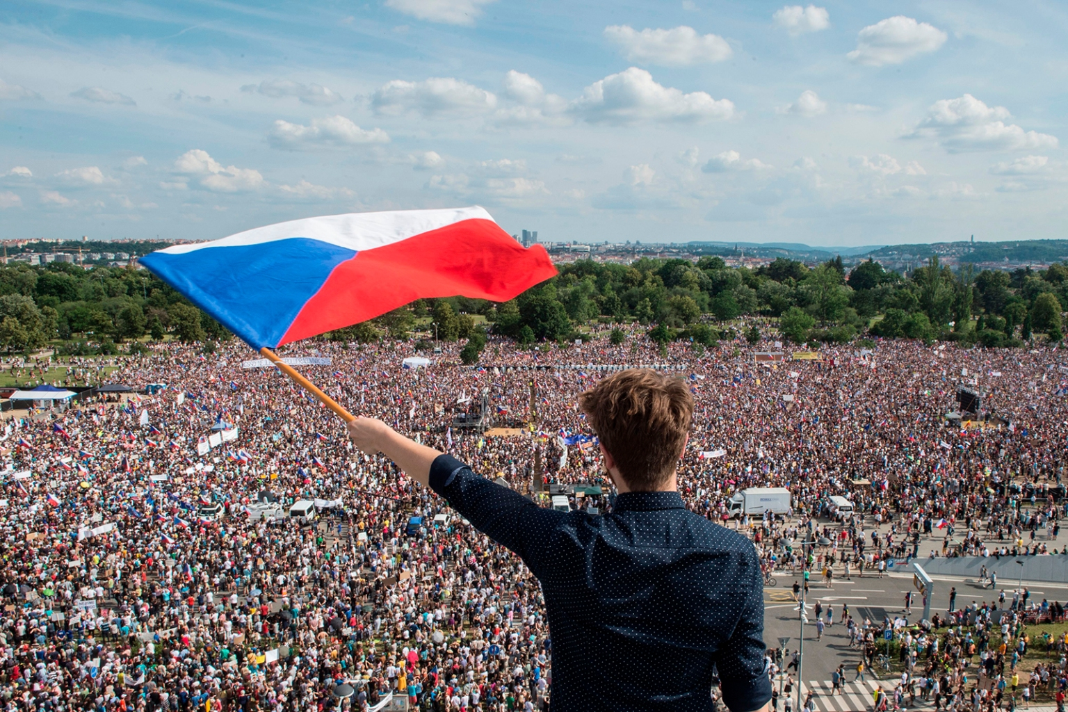A man holds a Czech National flag during a rally demanding the resignation of Prime Minister Andrej Babis in Prague on June 23. MICHAL CIZEK/AFP/Getty Images
