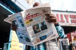 A man reads the _Reporter_ , an Ethiopian newspaper, depicting the portraits of Ambachew Mekonnen, the president of the country's Ahmara region, and of Gen. Seare Mekonnen, the chief of staff of the Ethiopian National Defense Force, in Addis Ababa on June 24.