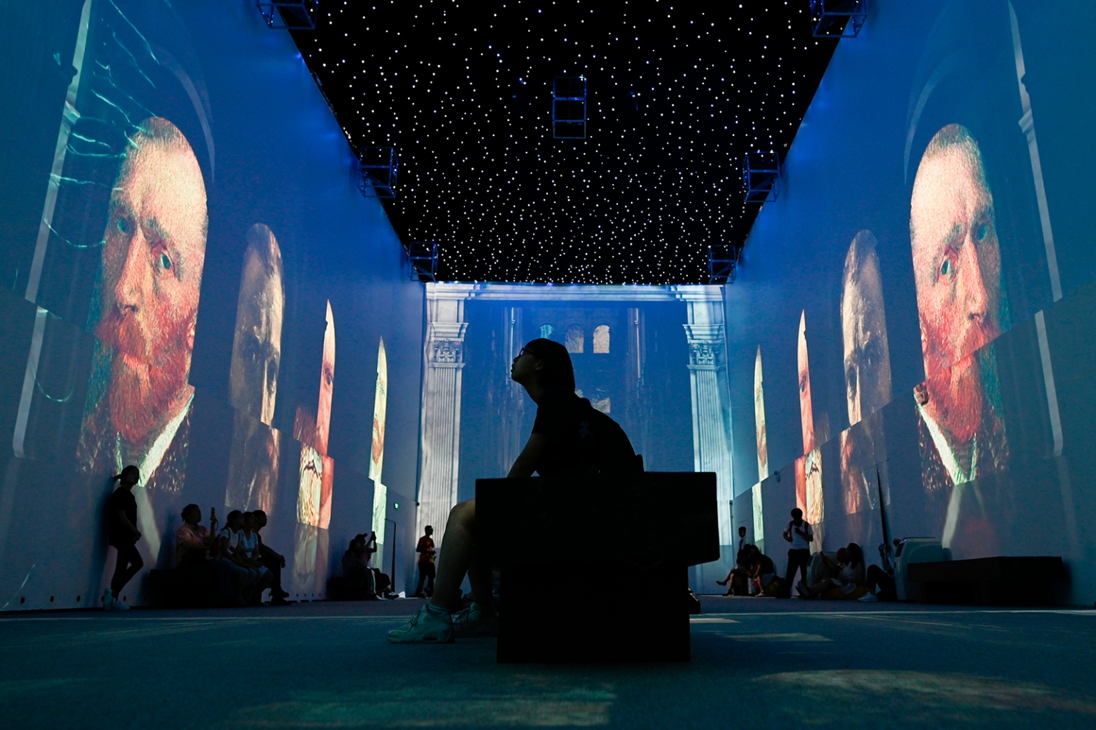 People visit an immersive exhibition about Vincent van Gogh in Beijing on June 25. WANG ZHAO/AFP/Getty Images