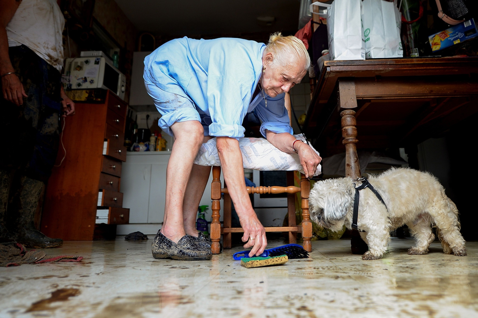 A woman cleans her house following heavy storms that brought damaing floods in the northwestern French city of Lisieux on June 25. JEAN-FRANCOIS MONIER/AFP/Getty Images