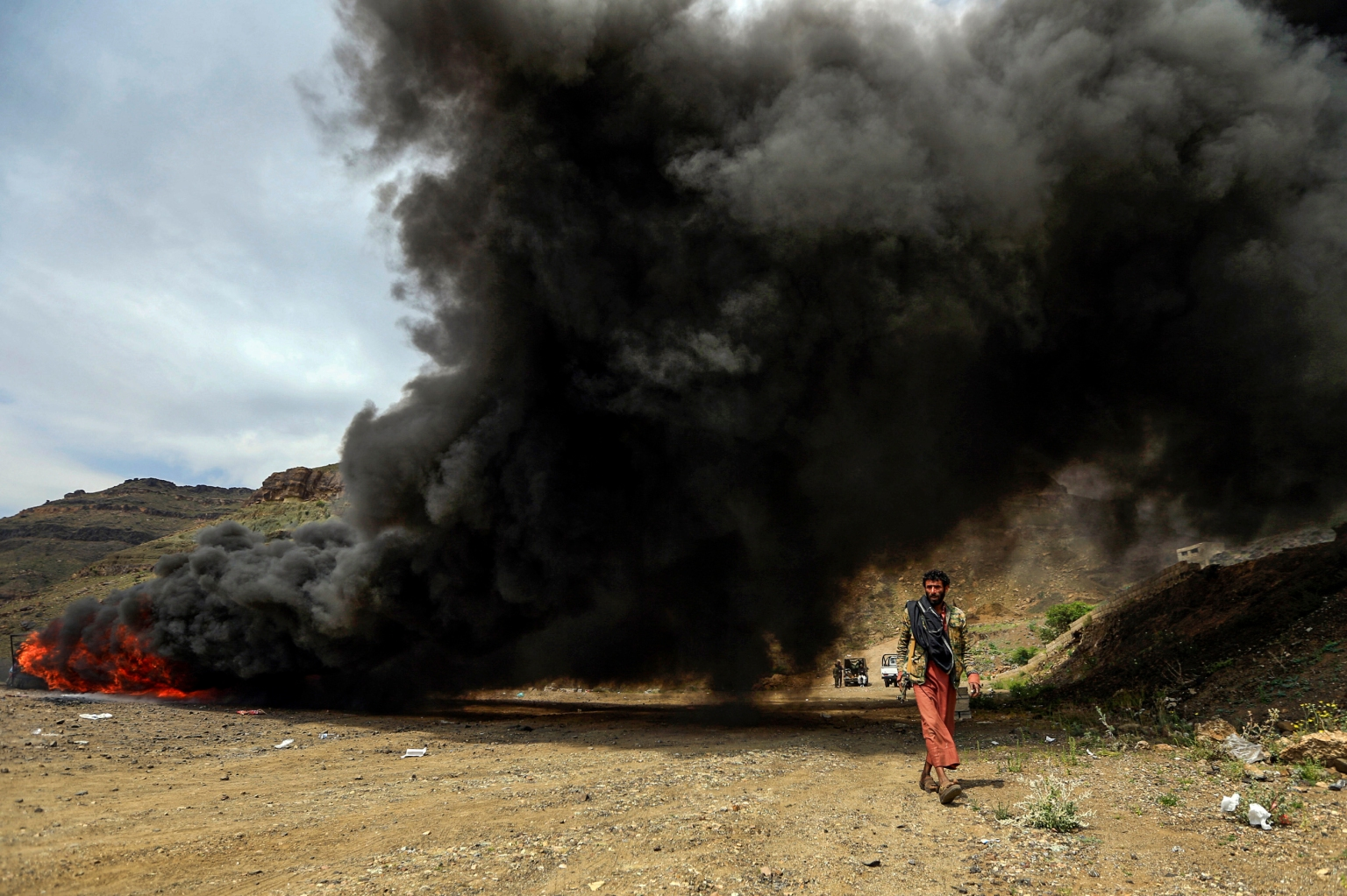 A Yemeni walks past a bonfire where narcotic substances seized by security forces loyal to Huthi rebels are incinerated in the rebel-held capital Sanaa on June 26. MOHAMMED HUWAIS/AFP/Getty Images