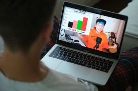 A young man looks at a recent video by German YouTube star Rezo that heavily criticizes the German Christian Democrats (CDU) political party on May 28, 2019 in Berlin, Germany.