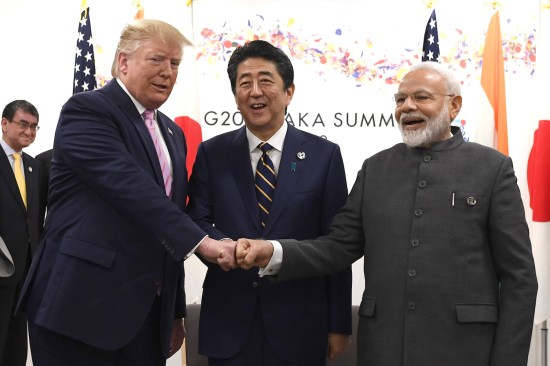 U.S. President Donald Trump fist-bumps Japanese Prime Minister Shinzo Abe and Indian Prime Minister Narendra Modi, during a meeting at the G-20 summit on in Osaka, Japan, on June 28.