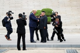 North Korean leader Kim Jong Un and U.S. President Donald Trump shake hands inside the demilitarized zone (DMZ) separating South and North Korea on June 30.