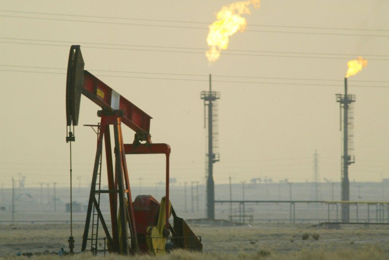 A derrick pumps in an oil field in Kuwait on Jan. 15, 2003.