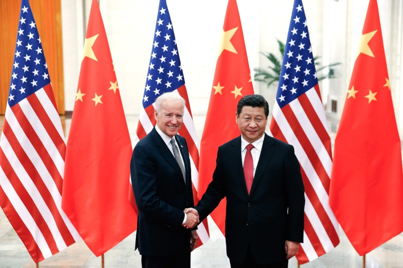 Then-U.S. Vice President Joe Biden shakes hands with Chinese President Xi Jinping in the Great Hall of the People in Beijing on Dec. 4, 2013.