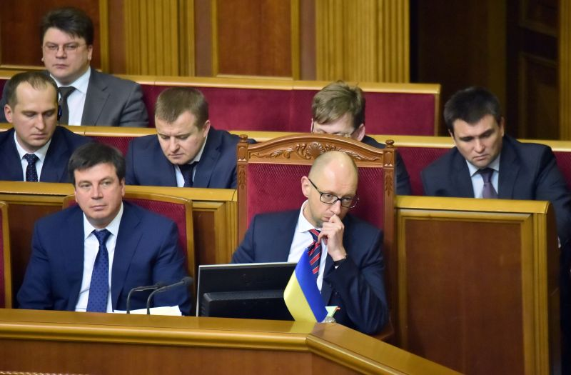 Ukrainian Prime Minister Arseniy Yatsenyuk and government ministers react prior to the voting of the government resignation at the parliament in Kiev on Feb. 16, 2016.