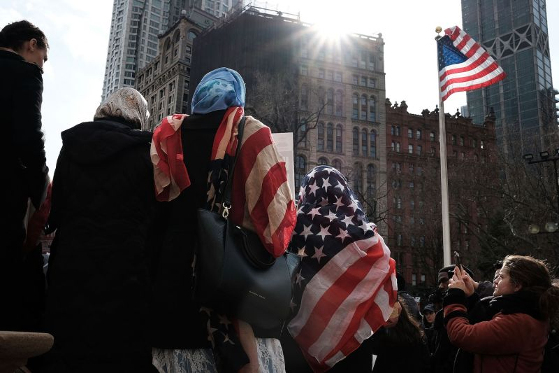 Women wear American flag headscarves at an event in New York City on Feb. 1, 2017.