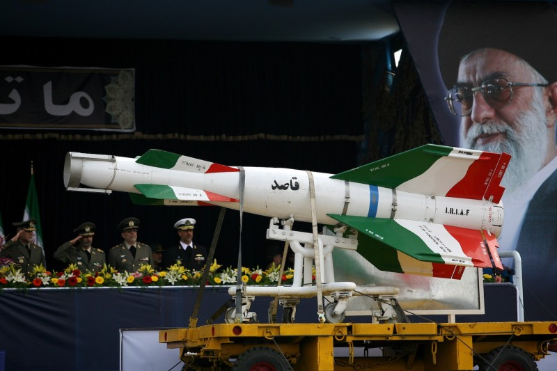 An Iranian missile is driven past portraits of Ayatollah Ali Khamenei during the annual army day military parade in Tehran on April 17, 2008.