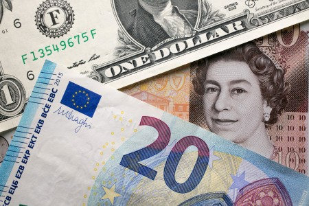 A photo illustration of euro, U.S. dollar, and British pound notes on Oct. 13, 2017.