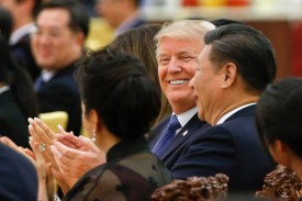 U.S. President Donald Trump and Chinese President Xi Jinping attend a state dinner in Beijing on Nov. 9, 2017.