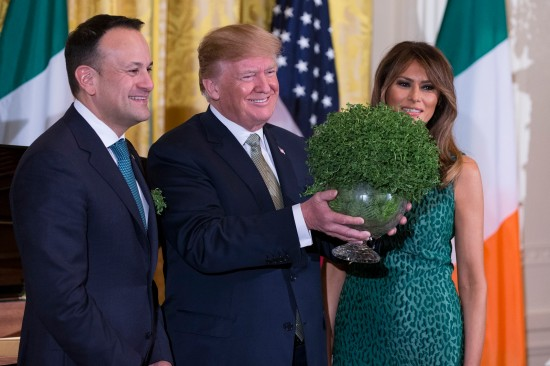 Prime Minister Leo Varadkar of Ireland, United States President Donald J. Trump, and first lady Melania Trump pose with a bowl of shamrocks presented by Varadkar to Trump on March 15, 2018 in Washington, D.C.