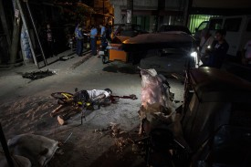The body of an alleged drug dealer lies on the ground after he was killed by an unidentified assailant in Manila on March 23, 2018.