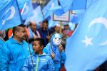 Ethnic Uighurs take part in a protest march calling on the European Union to do more on China's crackdown against Uighurs, in Brussels on April 27, 2018.