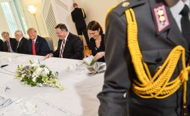 White House National Security Council aide Fiona Hill sits with U.S. National Security Advisor John Bolton, U.S. President Donald Trump, U.S. Secretary of State Mike Pompeo, and others during the summit with Russian President Vladimir Putin in Helsinki on July 16, 2018.