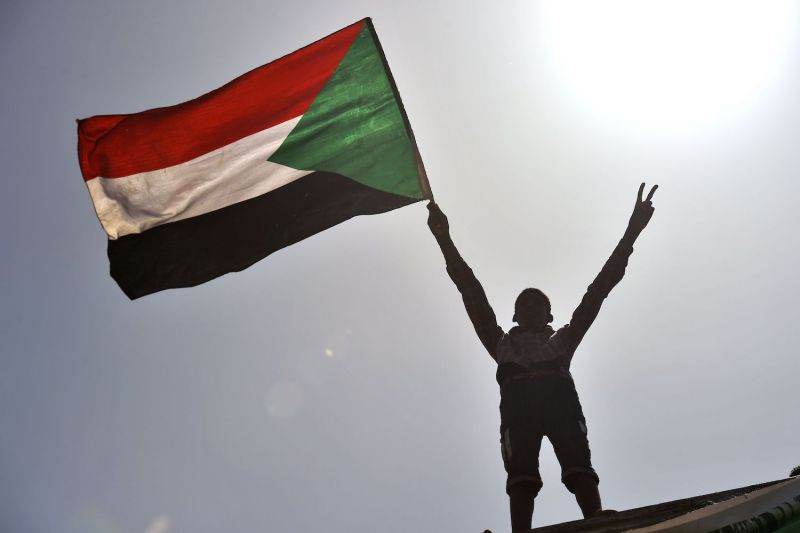 A protester waves a Sudanese flag in Khartoum on May 17.