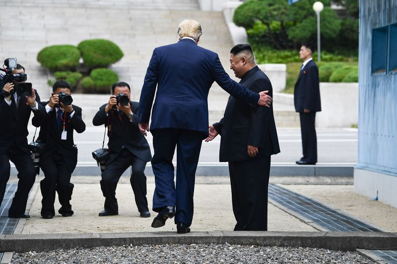 U.S. President Donald Trump steps onto the northern side of the military demarcation line that divides North and South Korea, next to North Korean leader Kim Jong Un in the Demilitarized Zone of Panmunjom on June 30.