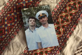 A family picture shows Andriy Oprysko, right, a 47-year-old seaman—one of 24 Ukrainian sailors who have been held captive by Moscow since the incident on the Kerch Strait—posing with his son, also named Andriy Oprysko.