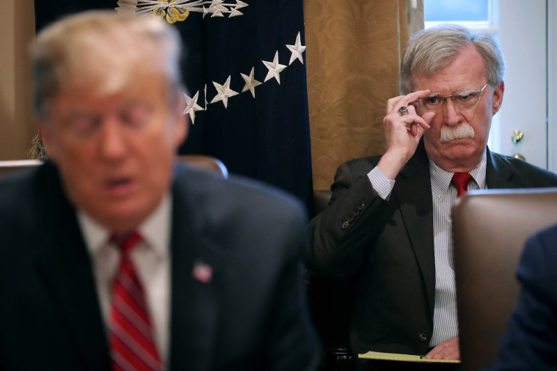 U.S. National Security Advisor John Bolton listens to U.S. President Donald Trump talk to reporters during a cabinet meeting of on February 12.