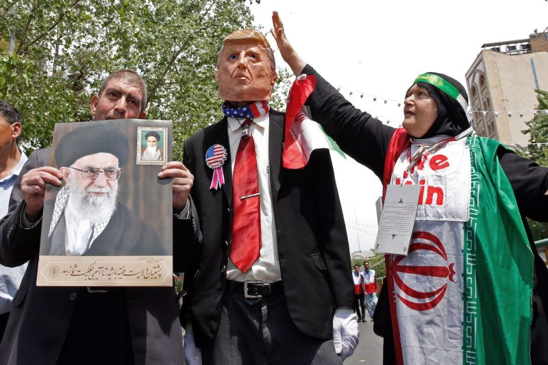 Iranian demonstrators carry a portrait of Iran's Supreme Leader Ali Khamenei and an effigy of U.S. President Donald Trump during a rally in the capital, Tehran, on May 10.