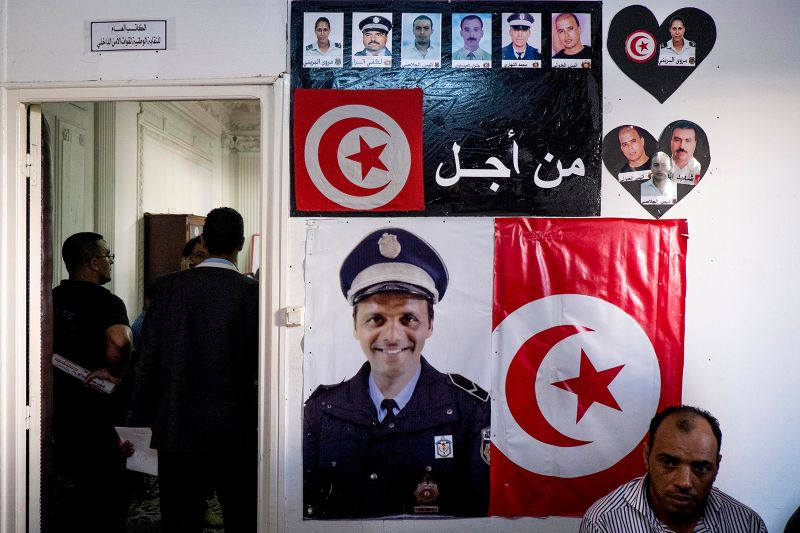 Policemen and residents demonstrate in the office of the main policy labor union in Tunis, Tunisia on Oct. 28, 2013.