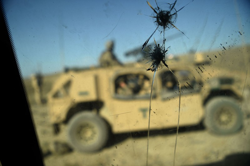 U.S. Army soldiers from NATO are seen through a cracked window in the Nangarhar province of Afghanistan on July 7, 2018.