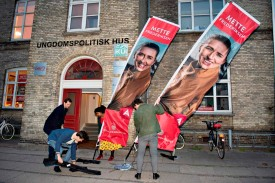 Youth members prepare for the visit of the head of the Social Democrats, Mette Frederiksen (displayed on banners), at a meeting celebrating the International Workers' Day in Aalborg, Denmark on May 1.