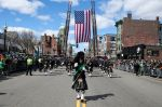 A pipes and drum band marches during the annual St. Patrick's Day parade in South Boston on March 17, 2019.