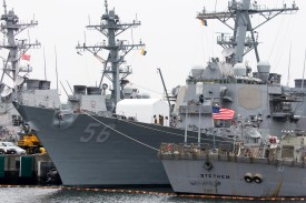 The USS John S. McCain (DDG 56) destroyer (C) is moored in a dock at the Yokosuka Naval Base on June 01, 2019 in Yokosuka, Japan. On Thursday, U.S. President Donald Trump has denied any involvement the move to hide the Navy Ship USS John S. McCain during his recent visit to its home port in Yokosuka, after reports emerged of emails being exchanged about keeping the ship out of view. (Photo by Tomohiro Ohsumi/Getty Images)