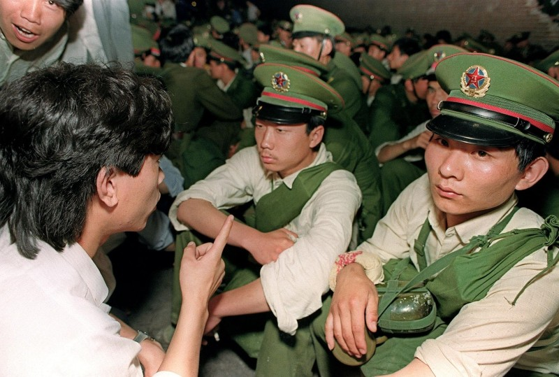 A dissident student asks soldiers to go back home as crowds flood into  central Beijing on June 3, 1989.