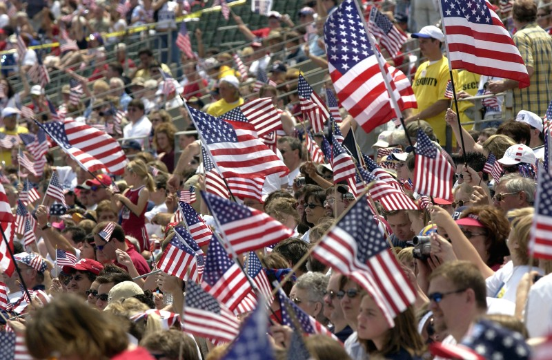 Supporters wave U.S. flags as they attend the Rally for America event at Marshall University stadium May 24, 2003 in Huntington, West Virginia.