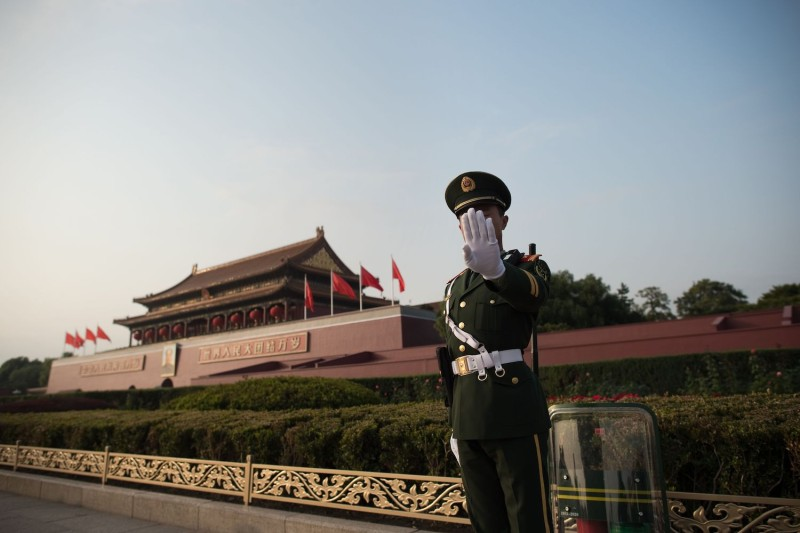A Chinese paramilitary officer stands near Tiananmen Square during the Communist Party's 19th Congress in Beijing on Oct. 22, 2017.