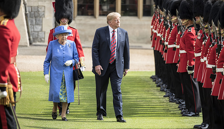 U.S. President Donald Trump and Britain's Queen Elizabeth II inspect a Guard of Honor at Windsor Castle on July 13, 2018.