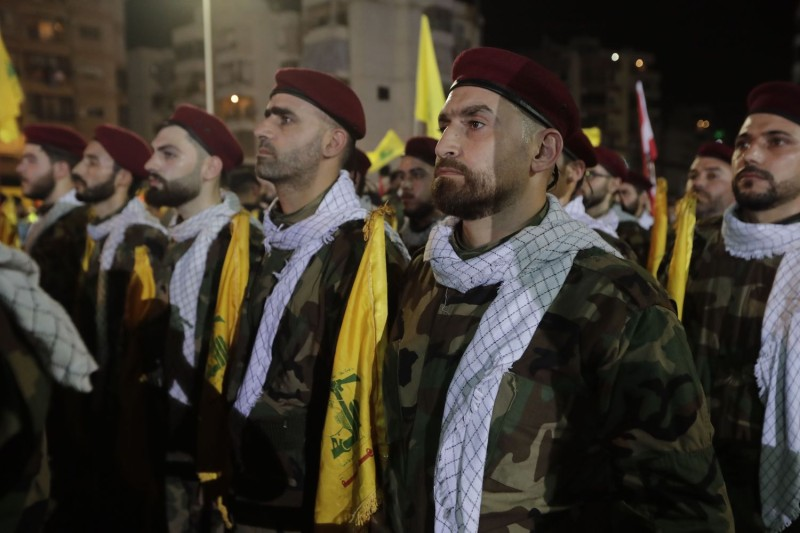 Fighters with the Lebanese Shiite Hezbollah party, carry flags as they parade in a southern suburb of the capital Beirut, to mark the al-Quds (Jerusalem) International Day, on May 31.