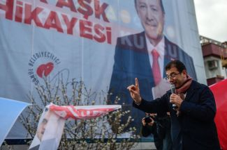 Ekrem Imamoglu, the mayoral candidate for the opposition Republican People's Party (CHP),  gestures as he speaks during a rally ahead of local elections in Istanbul on March 29. The election, which Imamoglu won narrowly, is scheduled to be re-run on June 23.