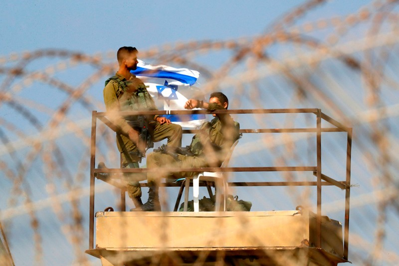 Israeli soldiers staff a watchtower along the border with the Gaza Strip on May 15, 2018.