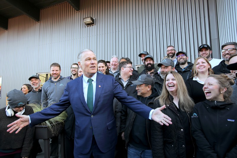 Jay Inslee visits a solar company in Seattle after announcing his run for president on March 1.