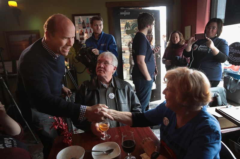 John Delaney greets guests at a soup luncheon in Knoxville, Iowa, on Feb. 17.