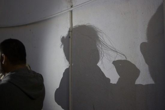 Shadows of migrants at a shelter in Mexicali, Mexico, en route to the United States on Nov. 15, 2018.