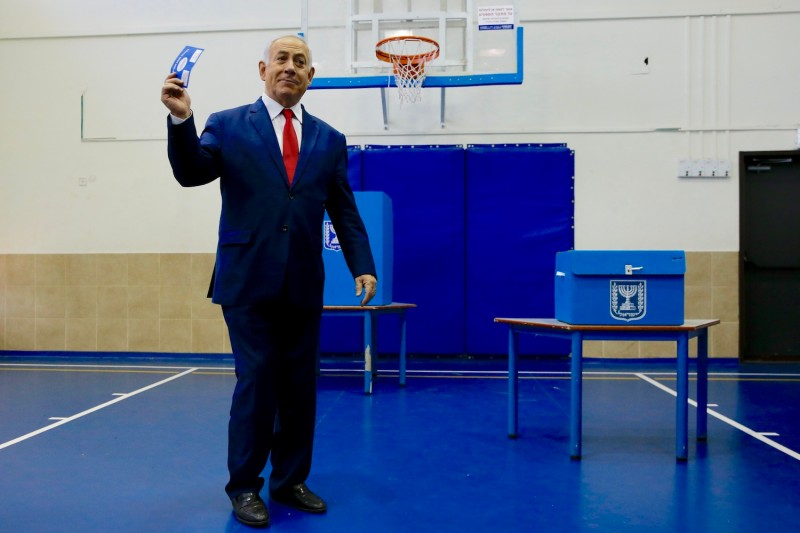 Israeli Prime Minister Benjamin Netanyahu casts his vote during Israel's parliamentary elections in Jerusalem, on April 9.