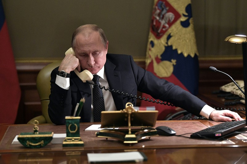 Russian President Vladimir Putin speaks on the phone in his office in St. Petersburg on Dec. 15, 2018.
