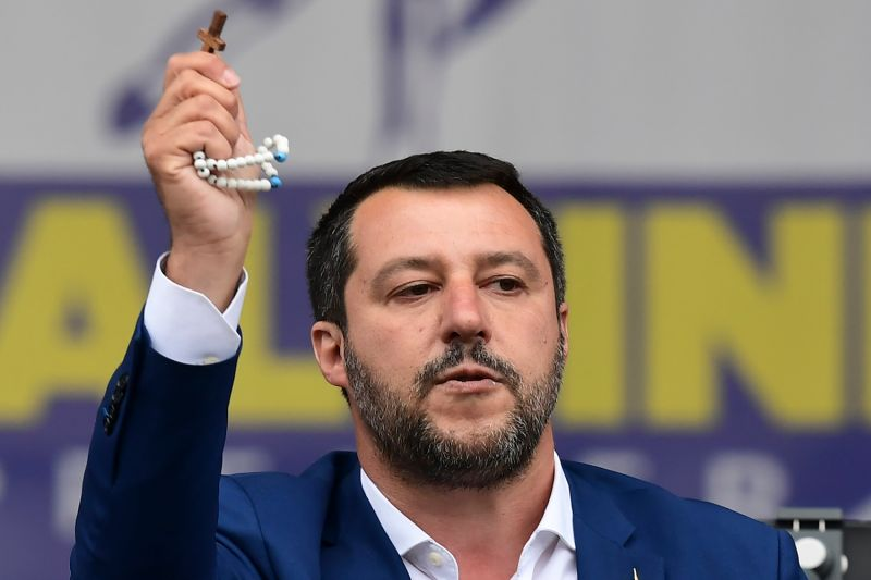 Italian Deputy Prime Minister and Interior Minister Matteo Salvini delivers a speech holding a rosary during a rally of European nationalists ahead of European elections on May 18, in Milan.