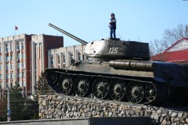 A child stands on the T-34 Soviet tank set as a monument in the center of Tiraspol, capital of self-proclaimed  Moldovan Republic of Transnistria on April 3, 2017.