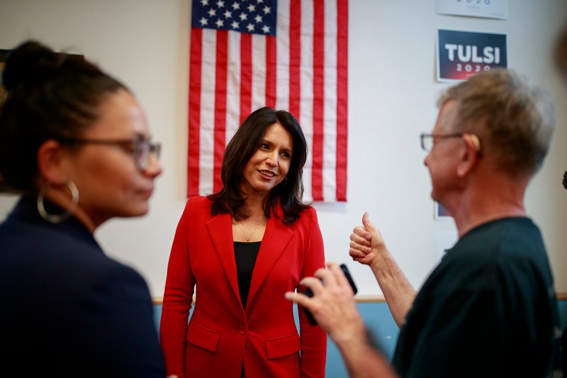 Tulsi Gabbard talks to veterans during a campaign rally in Iowa City on April 16.