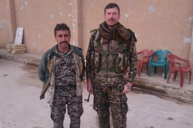 Tommy Morck stands next to a local SDF commander, Murat Amed, in Ayn Issa, Syria, on March 17, 2017.